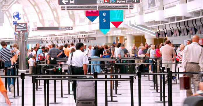 crowd waiting in line at an airport