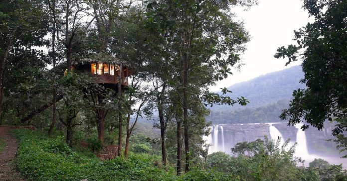 one of the unique rooms overlooking the waterfall at Rainforest Resort Athirapally