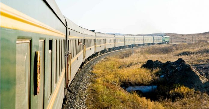 The trans-siberian train in the morning light making a curve.