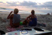 Two surfers on the beach in Santa Teresa, Costa Rica