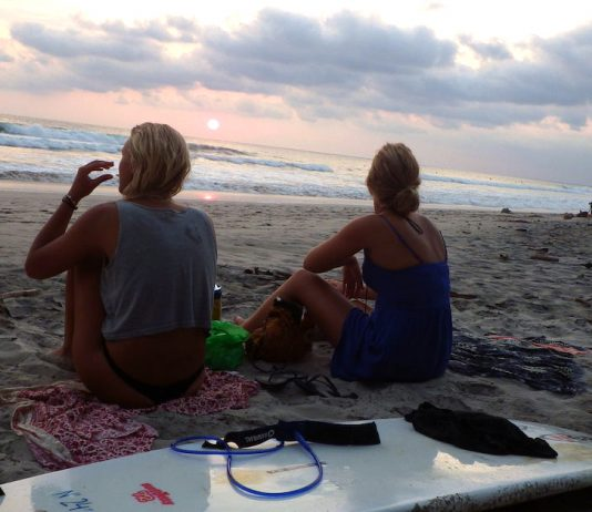 Two surfers on the beach in Santa Teresa, Costa Rica