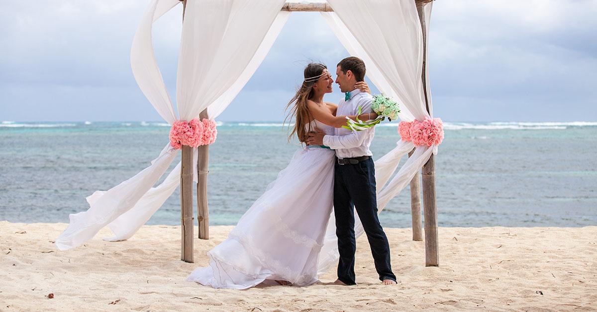 couple on the beach at wedding