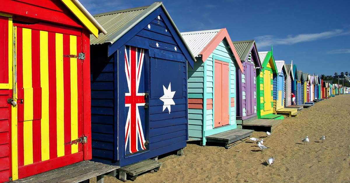 A row of brightly colored bath boxes at Brighton Beach in Melbourne Australia