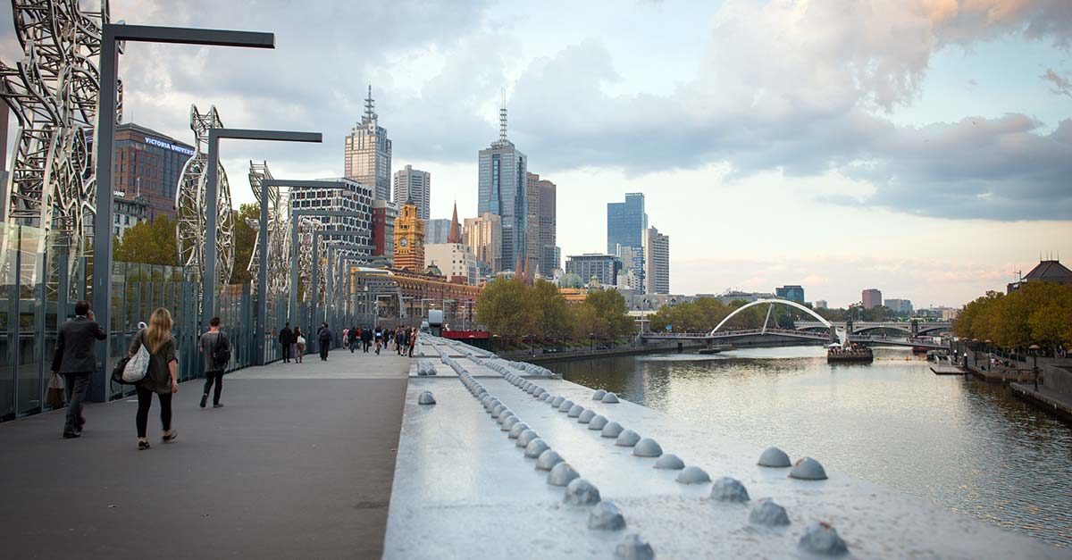 People walking along the Yarra River in Melbourne Australia