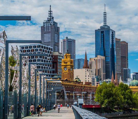 People walking along the Yarra River in Melbourne Australia