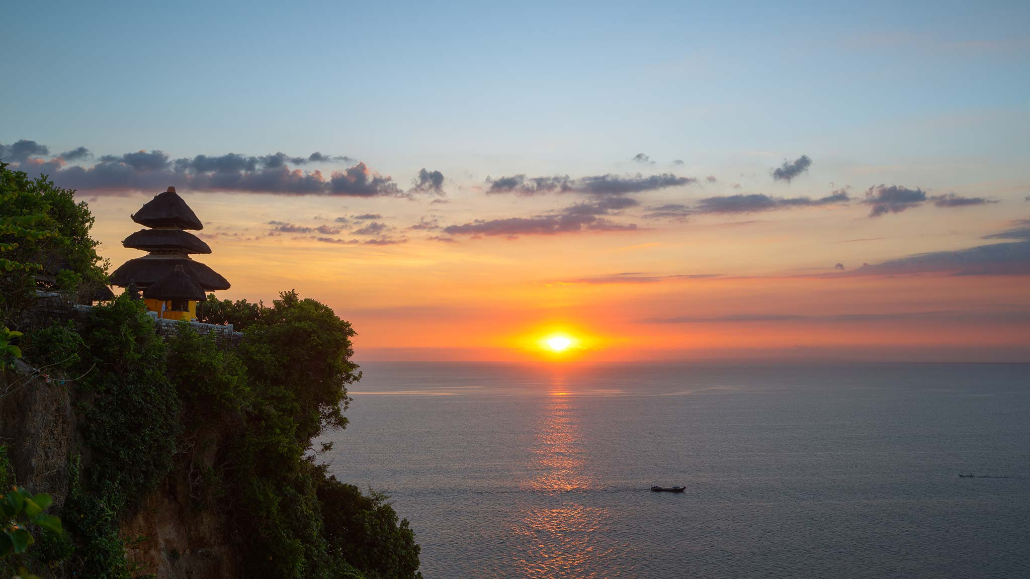View Uluwatu Temple overlooking the ocean in Bali