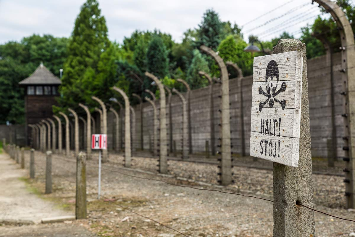 View of the fence surrounding the concentration camp at Auschwitz in Poland