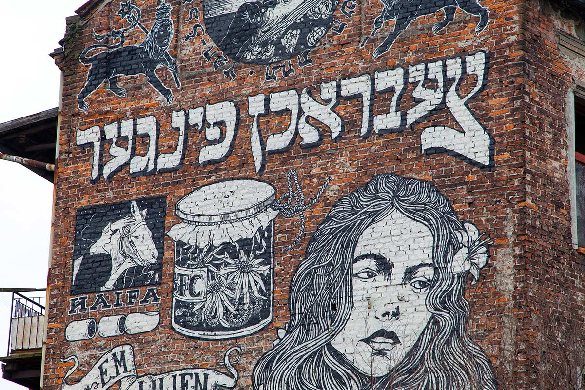 Street art on the side of a building in the Jewish Quarter of Krakow Poland