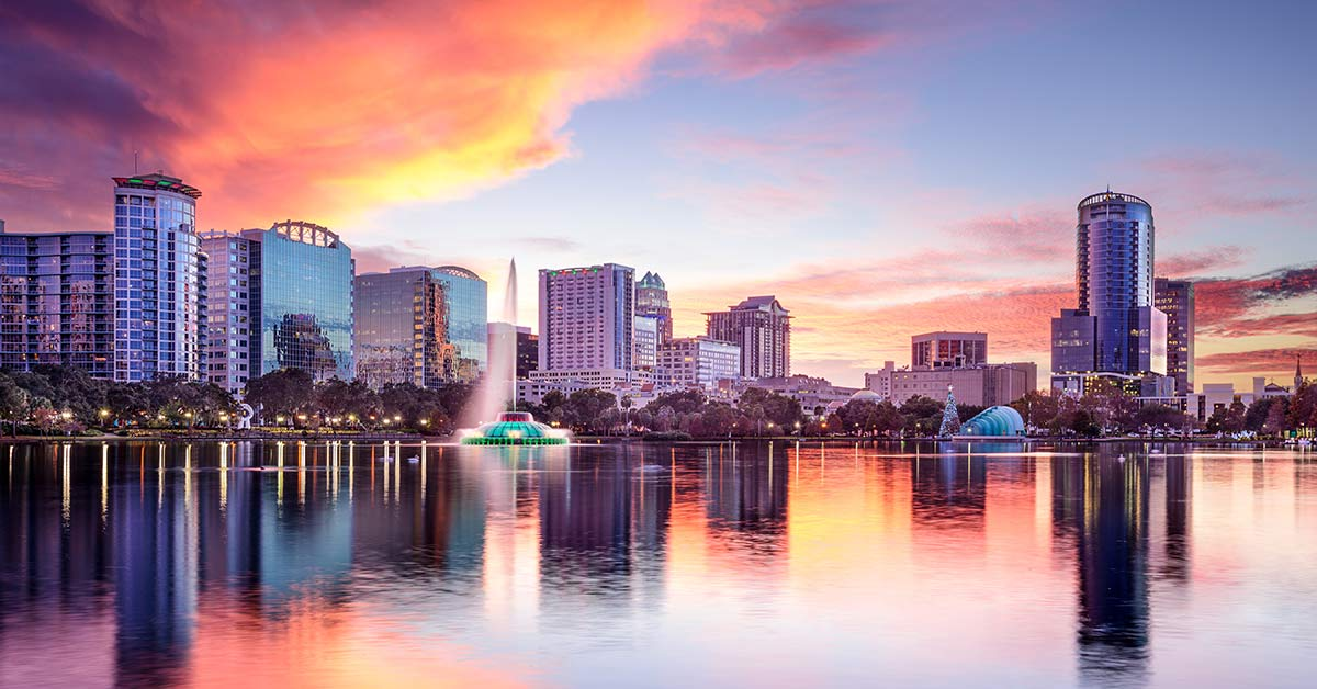 View of the Orlando, Florida Skyline reflecting in the water at sunset