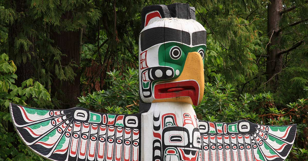 A wooden Totem pole in Vancouver British Columbia Canada
