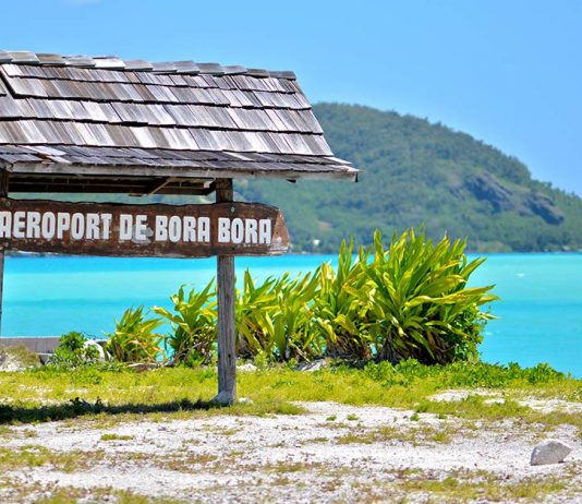 "A sign at the airport in Bora Bora that says ""Airport of Bora Bora"""