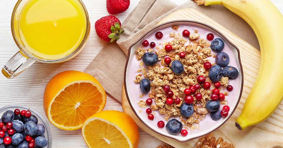 Healthy breakfast with granola, fruit and juice