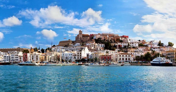 The harbor in Ibiza, Spain with the city reflecting in the water