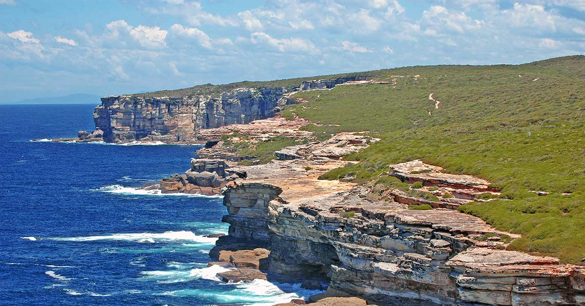 A view of the cliffs along the Coast Track hiking trail in Australia