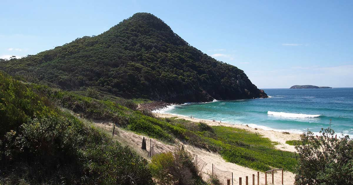 View of the ocean and nearby islands along the Tomaree Head Summit Walk hiking trail in Australia