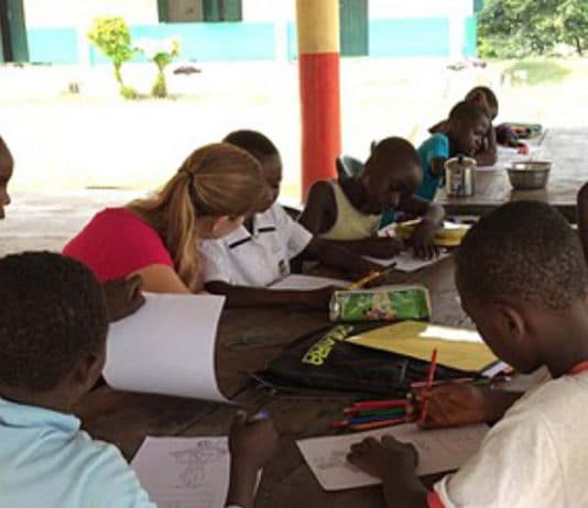 Volunteer teaching children while traveling