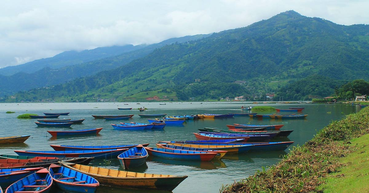 Colorful boats on Phewa Lake in Nepal