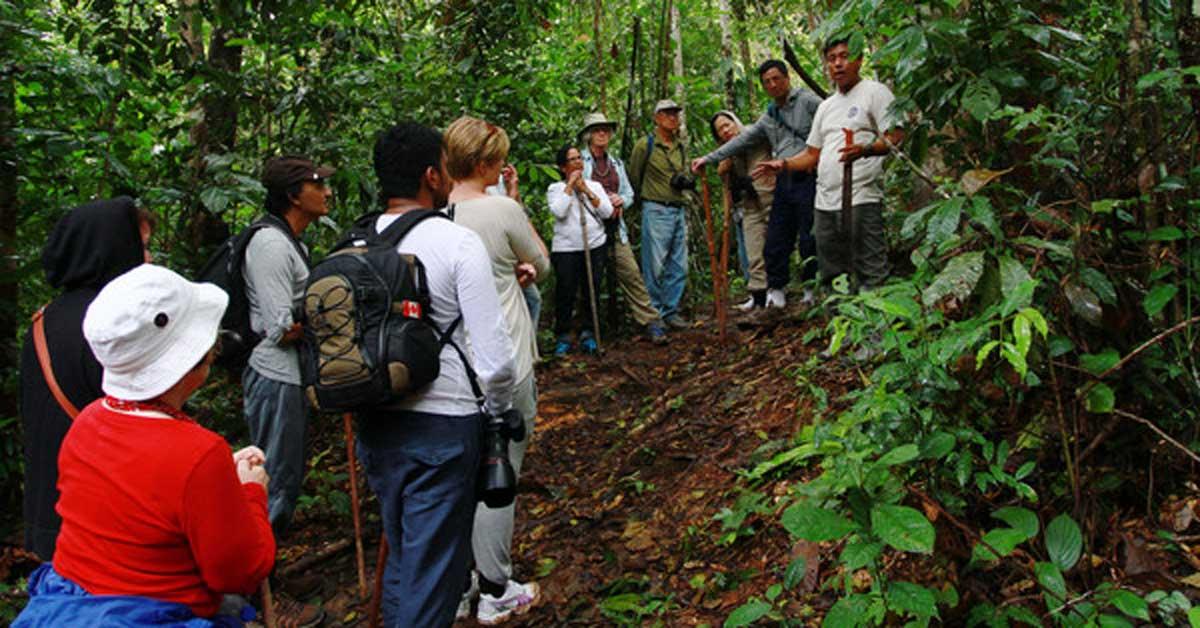 Tour group preparing to climb a mountain in Peru