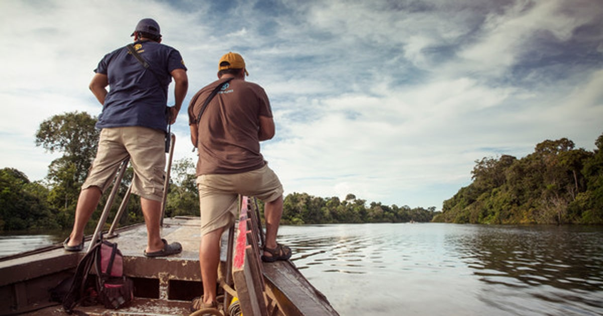 Travelers in a boat on the Amazon river in Peru