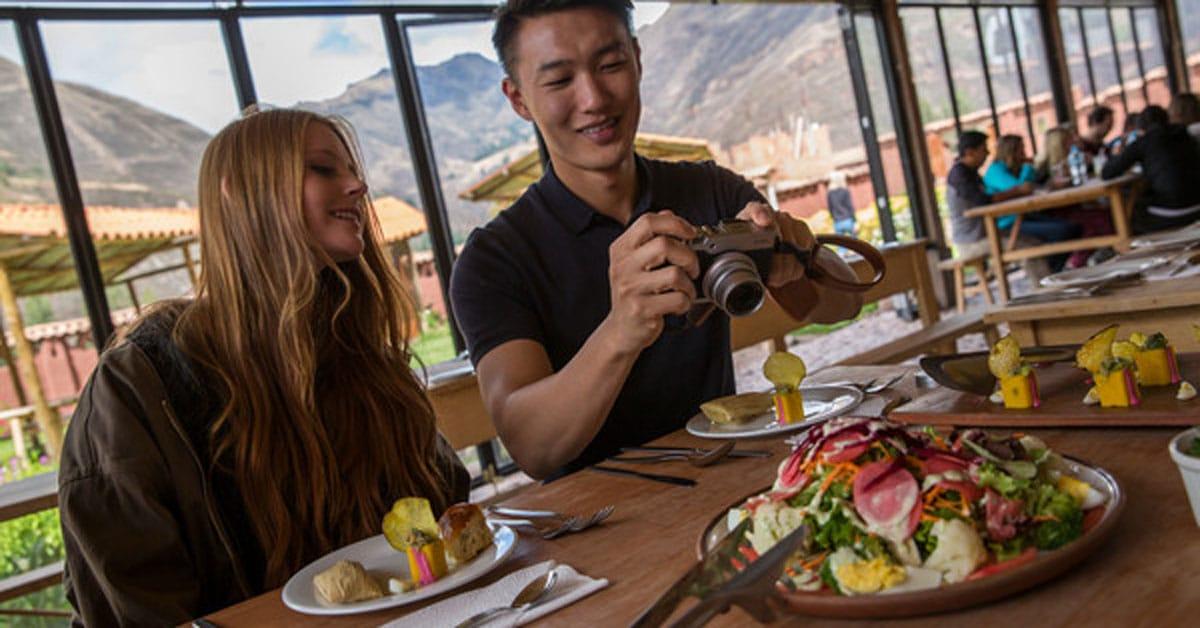 Travelers eating seafood in Peru