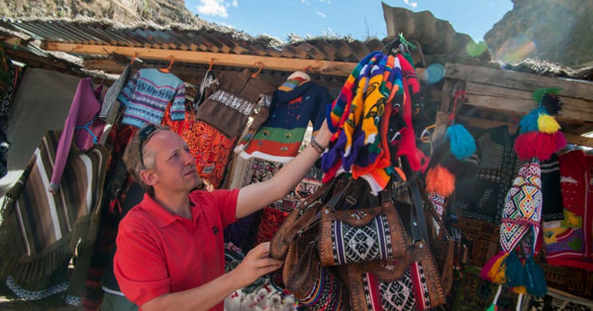 A traveler bartering with a street vendor in Peru