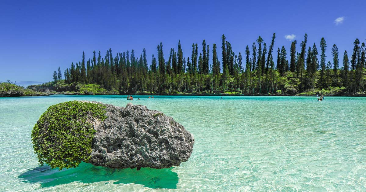 A family enjoying a swim in a lagoon in New Caledonia