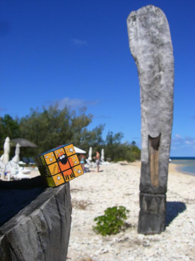 A rubix cube on the tip of boat on a beach. Duck Island, New Caledonia