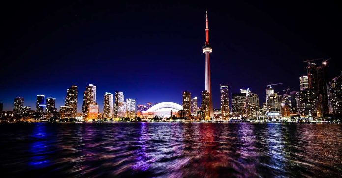 Toronto Skyline at night photo appearing in the travel article
