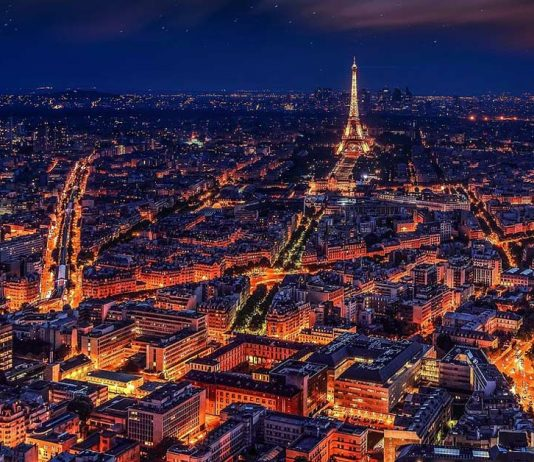 A view of Paris lights at night during the Summer. www.aTRAVELthing.com