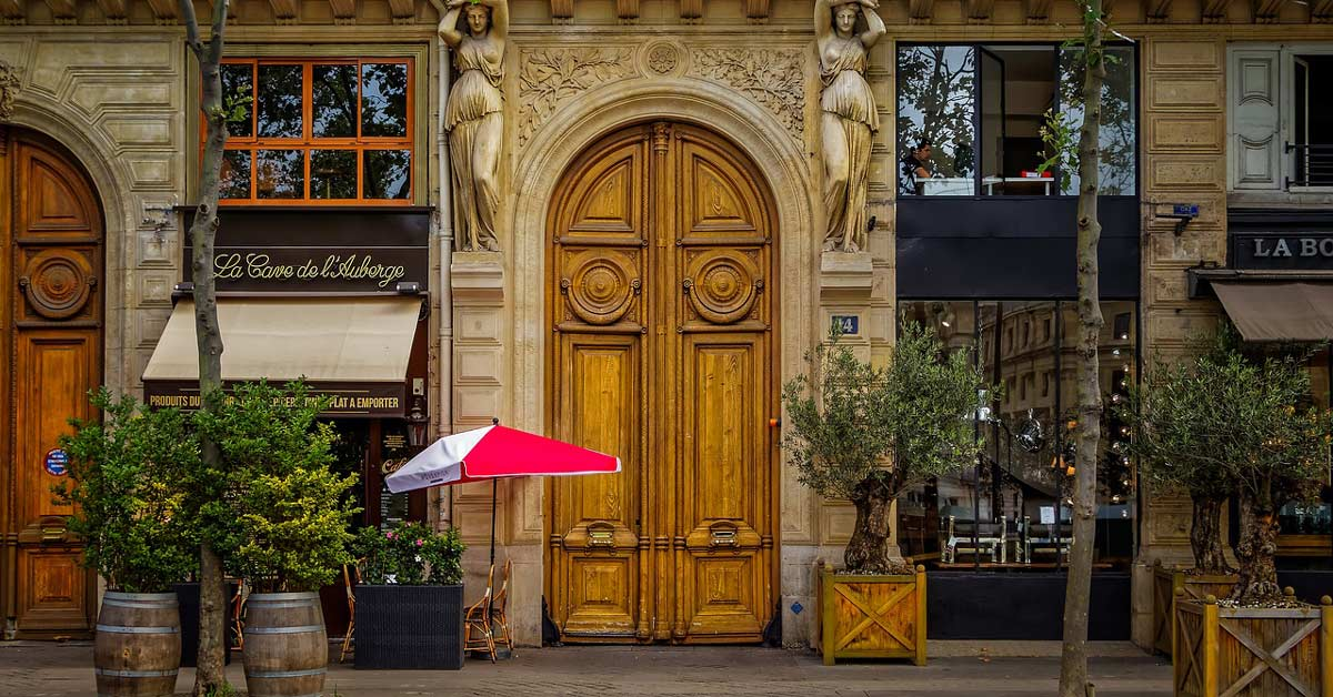 a beautiful wooden door seen from a street in Paris France. www.aTRAVELthing.com
