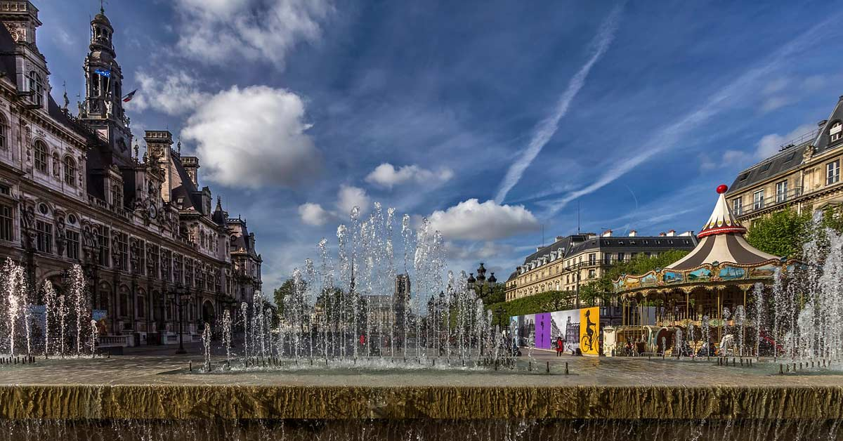A fountain in Paris during the summer with blue skies above. www.aTRAVELthing.com