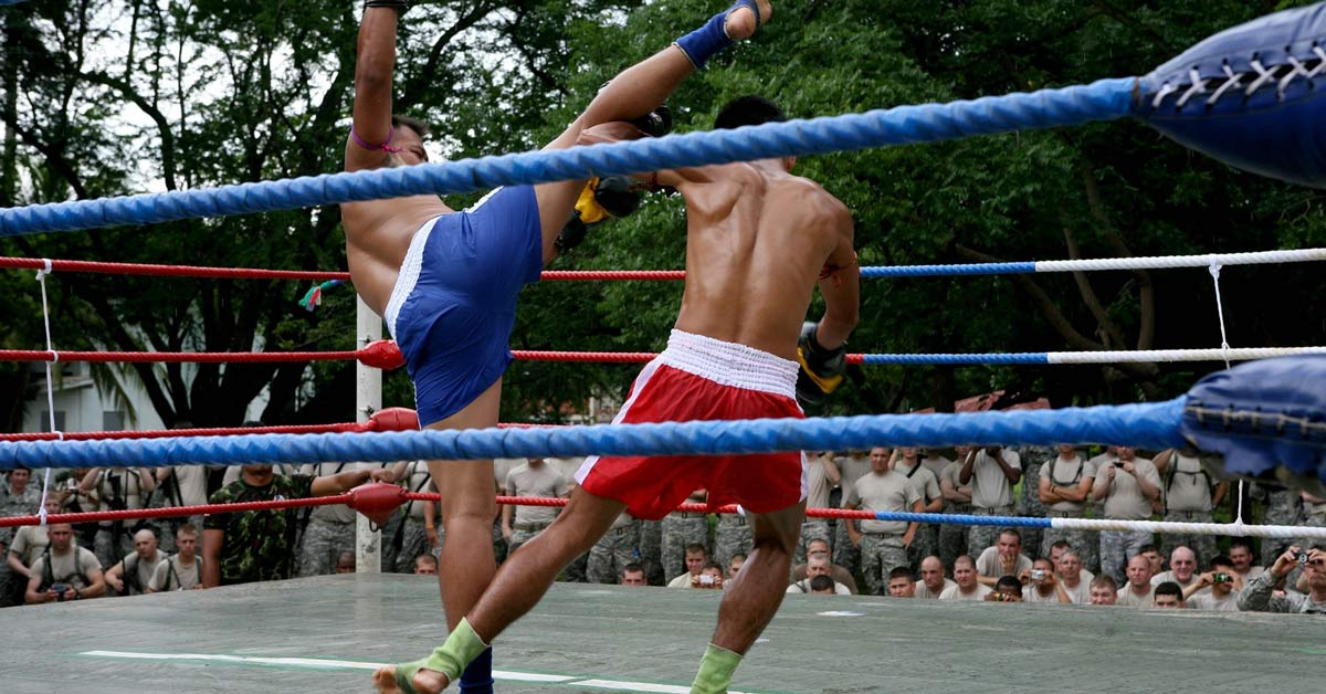 Two men in Thailand sparing during a Muay Thai kickboxing match. www.aTRAVELthing.com