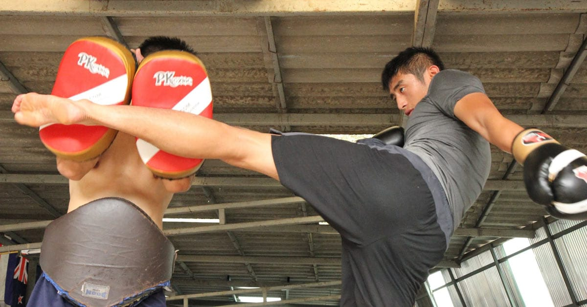 Thai men training Muay Thai kickboxing in Thailand. www.aTRAVELthing.com