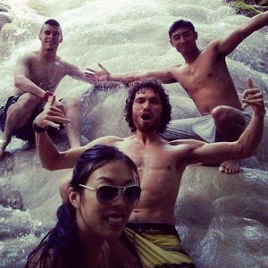 Brandon Leuangpaseuth with friends on a waterfall in Thailand. Contributor for www.aTRAVELthing.com