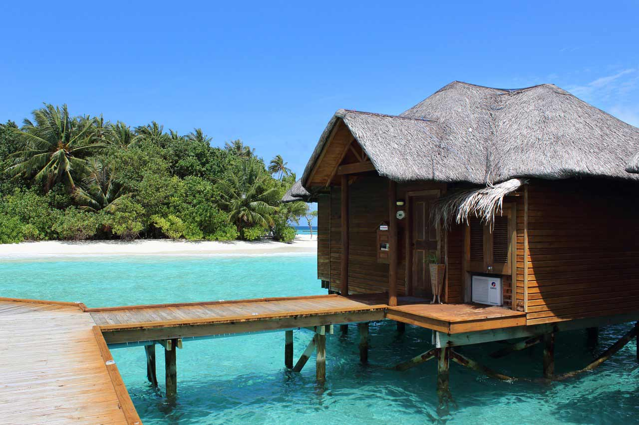 An over-water vacation rental on a beach in the Maldives