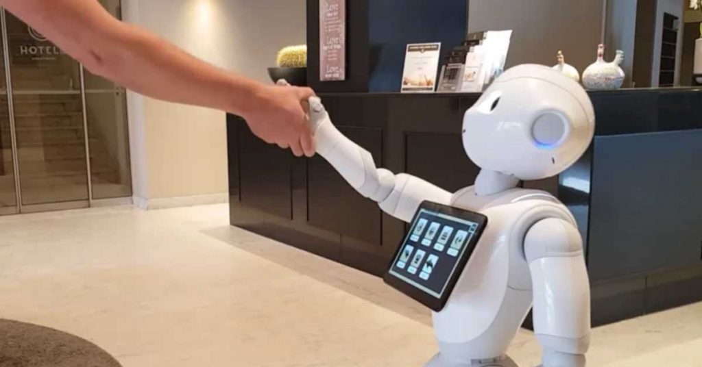 Someone shaking hands with Pepper the robot at the Hotel Andromeda