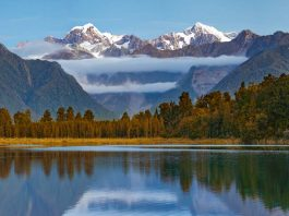 A view of a lake with Mount Tasman, New Zealand in the background.