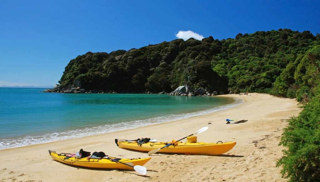 Kayaks on the beach in Tasman National Park New Zealand
