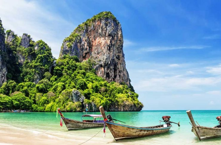 A view of boats on the beach in Phuket Thailand