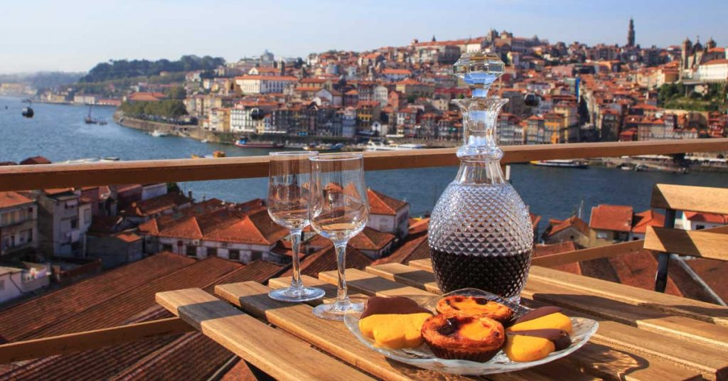 A bottle of port wine on a seaside table in Portugal.